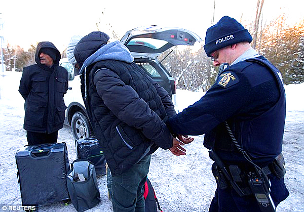 A family from Yemen are taken into custody after walking across the border into Hemmingford, Quebec.
