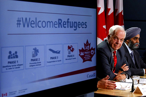 Canada's Immigration Minister John McCallum, left, and Defense Minister Harjit Sajjan (PHOTO: Chris Wattie—Reuters)